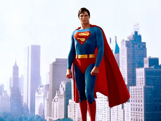 click to free download the wallpaper--Posters of TV & Movies, Superman Standing on Tall Buildings, He is Strong and Handsome