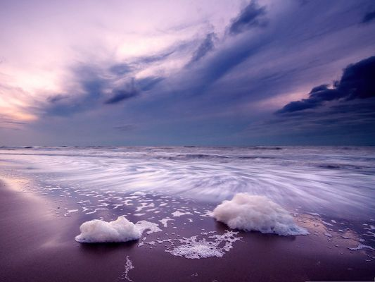 click to free download the wallpaper--Purple Beach Landscape, the Twisting Sea Under the Purple Sky, Great Look