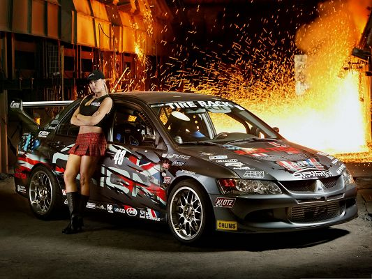 click to free download the wallpaper--Racing Mitsubishi Car, Hot Girl Leaning on Super Car, Fire Explosion