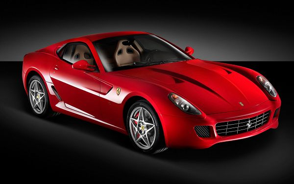 Red Ferrari Car in Stop, Must be Fast in Speed, on a Flat Black Road, Looking Really Good - Ferrari Cars Wallpaper