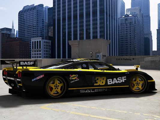 click to free download the wallpaper--Saleen Sport Car Wallpaper, Cool Black Car in the Stop, Tall Buildings Around