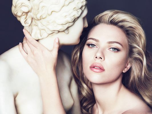 click to free download the wallpaper--Scarlett Johansson Wallpaper 2013, Close to a Beautiful Statue, Great in Look