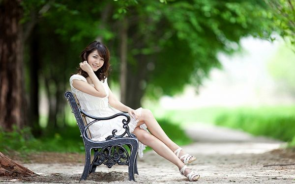 click to free download the wallpaper--Sitting Gracefully on a Chair, with White Dress and White Shoes, She is the Most Attractive - HD Attractive Girls Wallpaper