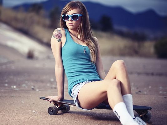 click to free download the wallpaper--Skater Girl Pictures, Floral Tattoo, Blue Casual Clothes and Dark Glasses