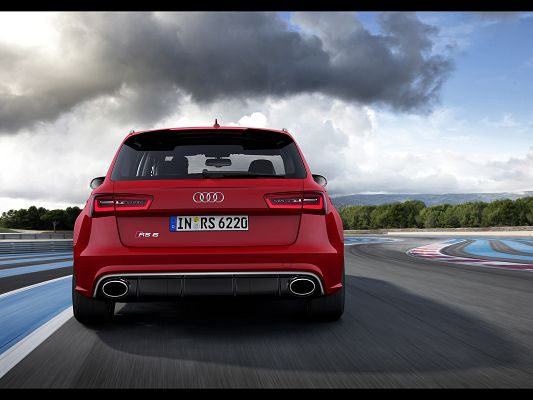 click to free download the wallpaper--Super Car Image of Audi RS6, a Red Car Running Fast Under the Dark Sky, Escaping the Rain?