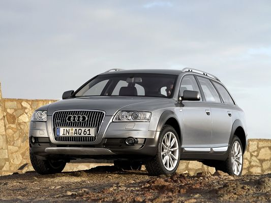 click to free download the wallpaper--Super Car Images, Audi A6 Allroad Among Nature Landscape, Under the Cloudy Sky