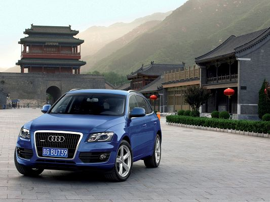 click to free download the wallpaper--Super Car Images, Audi Q5 Quattro Car Among Nature Scene, Old Houses and Tall Hills