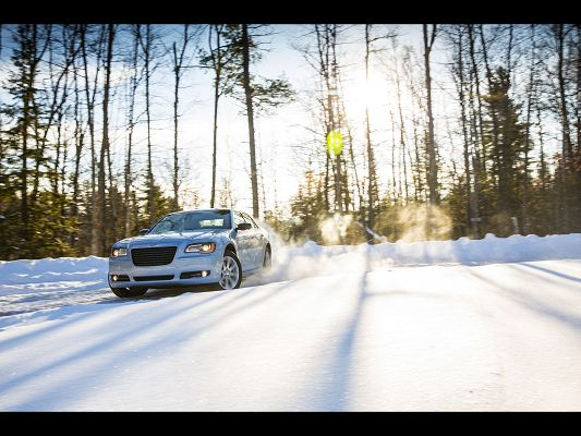 click to free download the wallpaper--Super Car Images of Chrysler 300, About to Start Out Like an Arrow, Snowy Scene