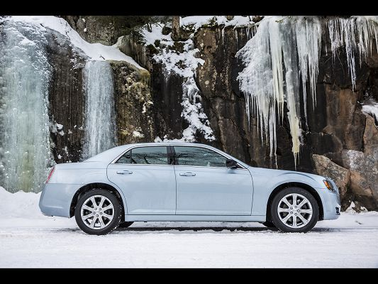 click to free download the wallpaper--Super Car Images of Chrysler 300, Freezing Waterfall, a Blue Car by the Side, Great Scene