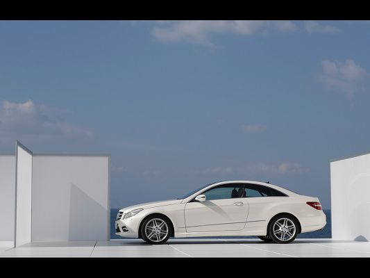 click to free download the wallpaper--Super Car Pics, E Class Coupe Side, White Glasses Around, the Blue and Cloudless Sky