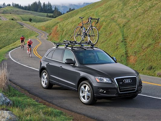 Super Car Pictures, Black Audi Q5 Lifting a Bike, Green Grass on the Hill