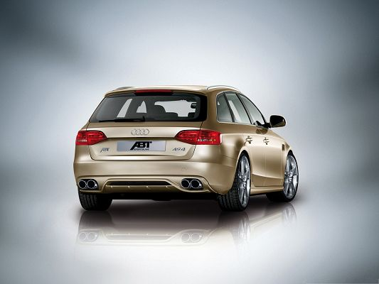 click to free download the wallpaper--Super Car Pictures, Golden Audi AS4 Avant Car on Gray Background, Nice Look