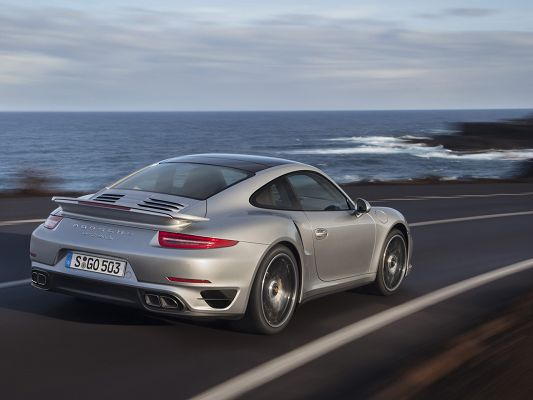 click to free download the wallpaper--Super Car Post of Porsche 911, Running by Seaside, They Are Both Impressive