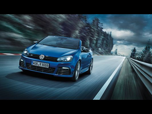 click to free download the wallpaper--Super Car Post of Volkswagen Golf R, Seen from Motion Front, Blue Car in the Run