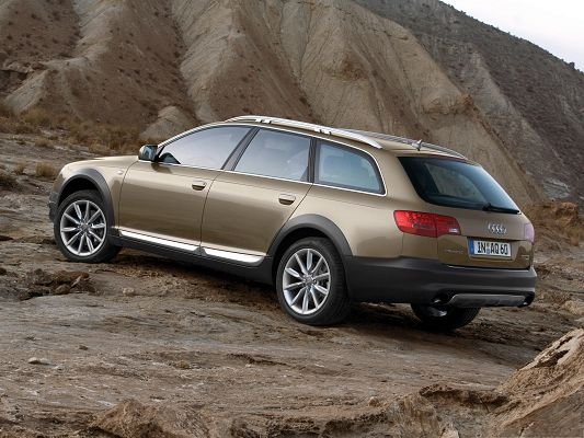 click to free download the wallpaper--Super Car Wallpaper, Audi A6 Allroad Car Among Natural Scene, Tall Hills Alongside