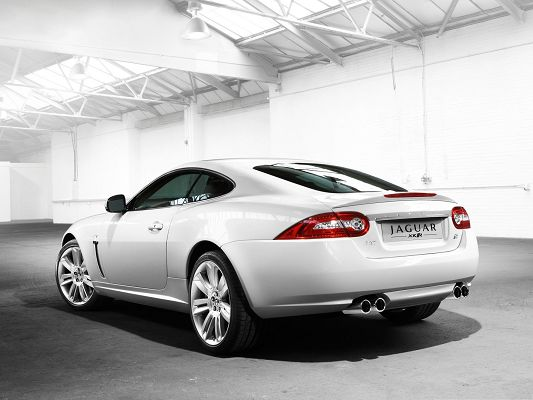 click to free download the wallpaper--Super Car as Background, White Jaguar Car on Black and Flat Road, Decent Look