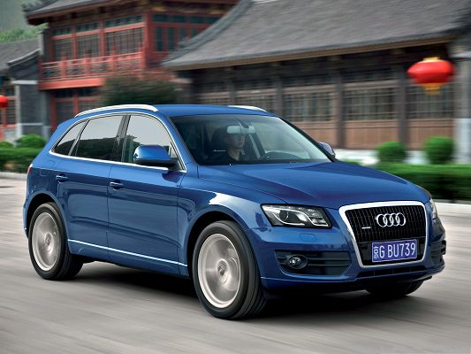 Super Car as Wallpaper, Blue Audi Q5 in Fast Run, Old Houses Alongside