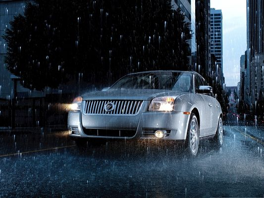 click to free download the wallpaper--Super Cars Background, Silver Mercury Car in Heavy Rain, Looking Incredible