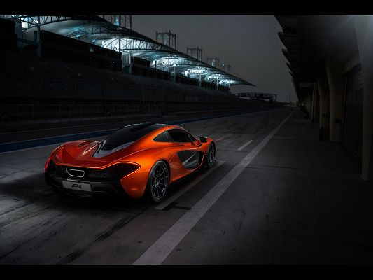 Super Cars Image of McLaren P1, an Orange Car on Black Road, It is Like a Monster at Night