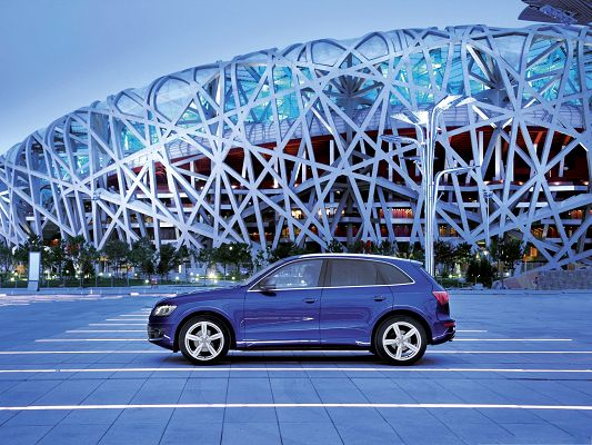 click to free download the wallpaper--Super Cars Picture, Blue Audi Q5 on Flat Road, Facing the Bird's Nest