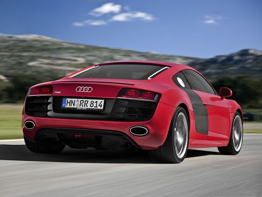 click to free download the wallpaper--Super Cars Picture, Red Audi R8 Car in Fast Run, Under the Blue Sky