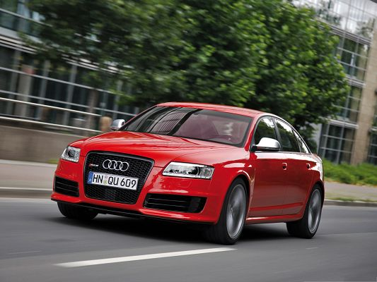 click to free download the wallpaper--Super Cars Wallpaper, Audi RS6 Sedan Car in Fast Speed, Tall Green Trees Around