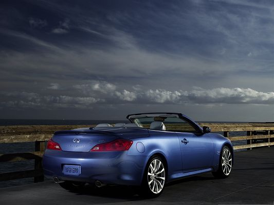 click to free download the wallpaper--Super Cars Wallpaper, Blue Infiniti Car for Widescreen, Next to the Sea