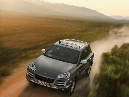 click to free download the wallpaper--Super Cars Wallpaper, Gray Porsche Cayenne on Earthy Road, Thick Smoke Behind