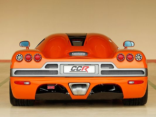 click to free download the wallpaper--Super Cars Wallpaper, Orange Koenigsegg CCR in Rear Look, Nice and Impressive
