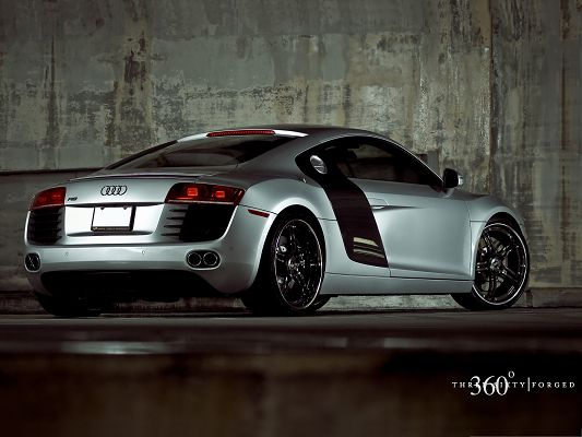 click to free download the wallpaper--Super Cars as Background, Audi Car Turning a Corner, Facing Wet Walls