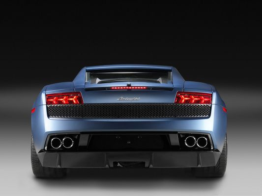 click to free download the wallpaper--Super Cars as Background, Blue Lamborghini Sport Car from Rear Look, Dusk Background