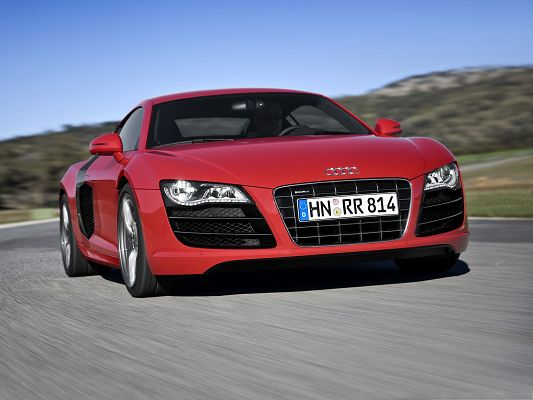 click to free download the wallpaper--Super Cars as Wallpaper, Red Audi R8 Car in Great Speed, Tall Green Hills Alongside