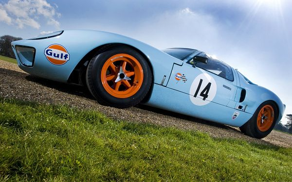 click to free download the wallpaper--Super Race Car Wallpaper, Blue Car in the Stop, Green Grass Alongside
