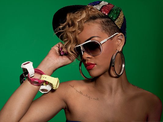 click to free download the wallpaper--Super Stars Wallpaper, Rihanna Rude Boy, Big Glasses and Ring, Colorful Watches