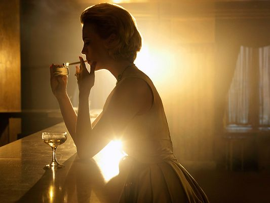 click to free download the wallpaper--Taking Part in Pirate Radio, Unknown and AMC's Mad Men, She is Smiling and Down, Yet the Lighting Effect is Beautiful - HD January Jones Wallpaper