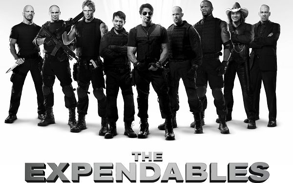 click to free download the wallpaper--The Expendables in 2560x1600 Pixel, All Guys in Black Suit, Together They Are Cool and Tall, Shall Fit Various Devices - TV & Movies Wallpaper