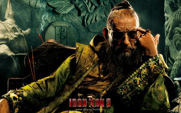click to free download the wallpaper--The Mandarin Post in Iron Man 3 in 2880x1800 Pixel, Man Sitting on Chair and Planning Something Big, He is Bound to Make It - TV & Movies Post