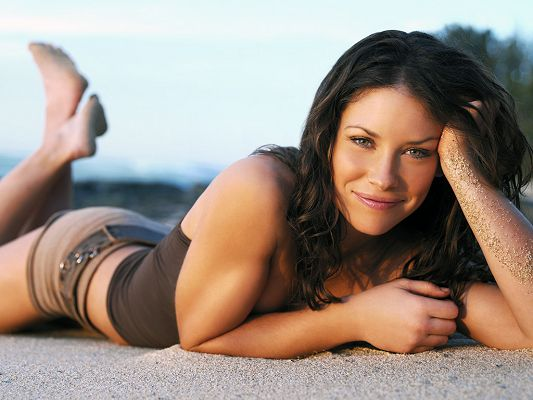 click to free download the wallpaper--Took Part in The Hurt Locker and ABC's Lost, Lying by Beachside, Feet are High and Swinging, Looking Really Good - HD Evangeline Lily Wallpaper