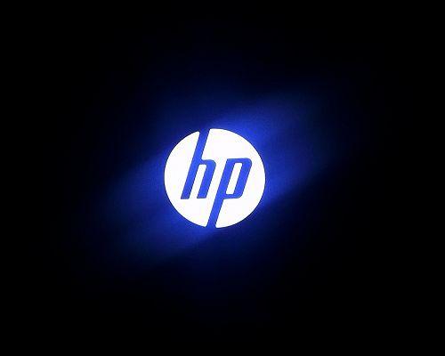 Top Brandy Post, HP Logo Generating Blue Light, Black Background
