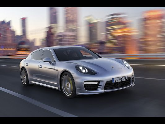 Top Car Photos of Porsche Panamera, a Great Car in the Run, Surrounding Scenes Are Rushing Behind