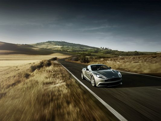 click to free download the wallpaper--Top Car Pics, Aston Martin in Rural Area, Speed is Never a Concern