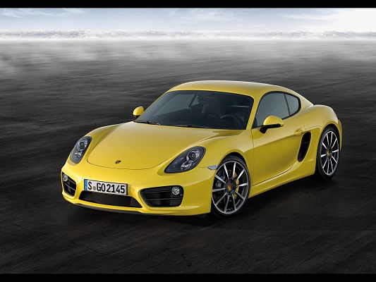 click to free download the wallpaper--Top Car Pics of Porsche Cayman, Seen from Front Angle, the Car is in High Detail and Quality