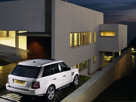 click to free download the wallpaper--Top Car as Background, White Range Rover Car Next to the Lighted House