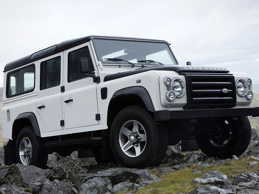 click to free download the wallpaper--Top Cars Pic, Land Rover in Jeep Front, Steady Run on Big Rocks