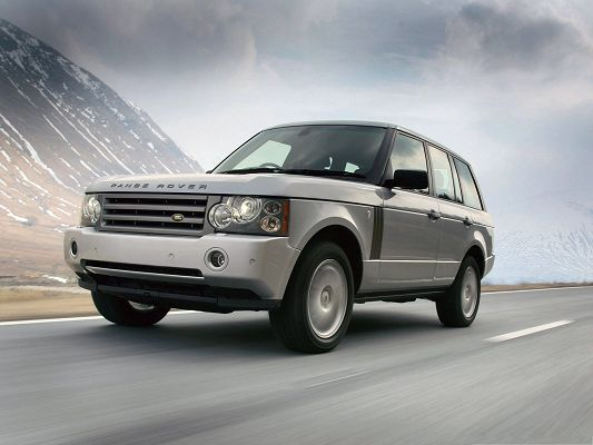 click to free download the wallpaper--Top Cars Picture, Gray Range Rover Car in Fast Speed, Under the Blue Sky
