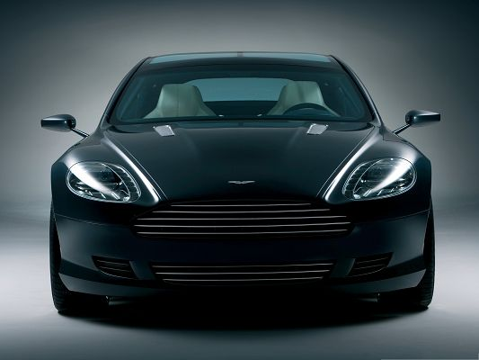 click to free download the wallpaper--Top Cars Wallpaper, Black Aston Martin Car, Glowing Body, on Flat Road