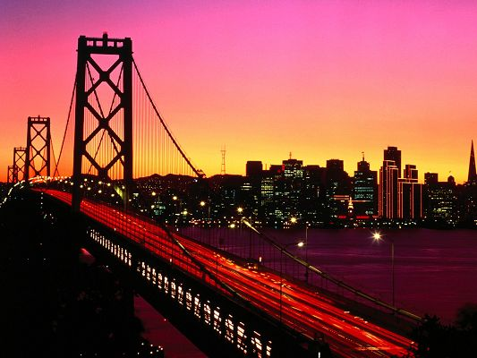 Treasure Island HD Post in Pixel of 1600x1200, a Lighted up Bridge, Surrounded by Tall Buildings, Amazing Walking Experience - HD Natural Scenery Wallpaper