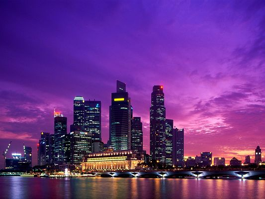 click to free download the wallpaper--Twilight Singapore Post in Pixel of 1600x1200, Colorful Lights Are Generated, Have Fun in the Sleepless City - HD Natural Scenery Wallpaper