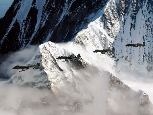 click to free download the wallpaper--War Airplane as Wallpaper, Four Super Planes Flying Over Snow-Capped Mountains
