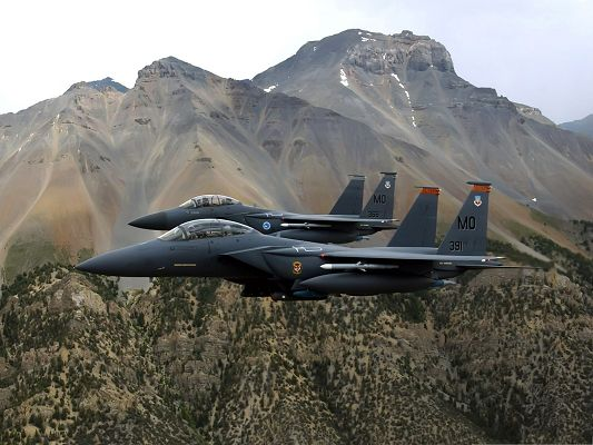 click to free download the wallpaper--War Airplanes Wallpaper, Super Duty Plane Flying Among Tall Mountains